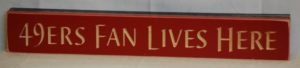 WS9144RD-49s Fan Lives Here – 2′ Wooden Sign – Red