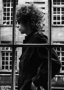 The one and only Bob Dylan pictured walking past a shop window in London May 1966